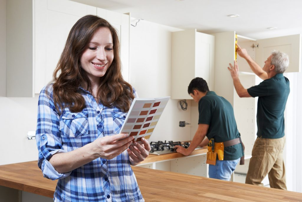 Woman Choosing Colors for Cabinets