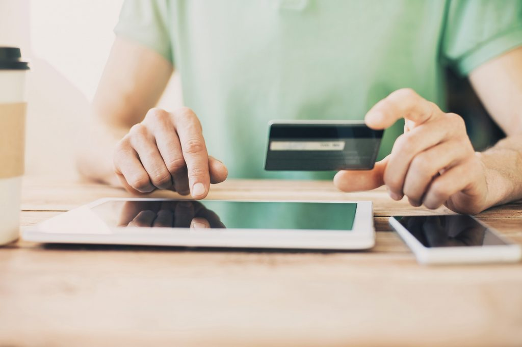 Holding Credit Card with Tablet