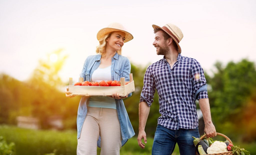 Couple Holding Vegetables