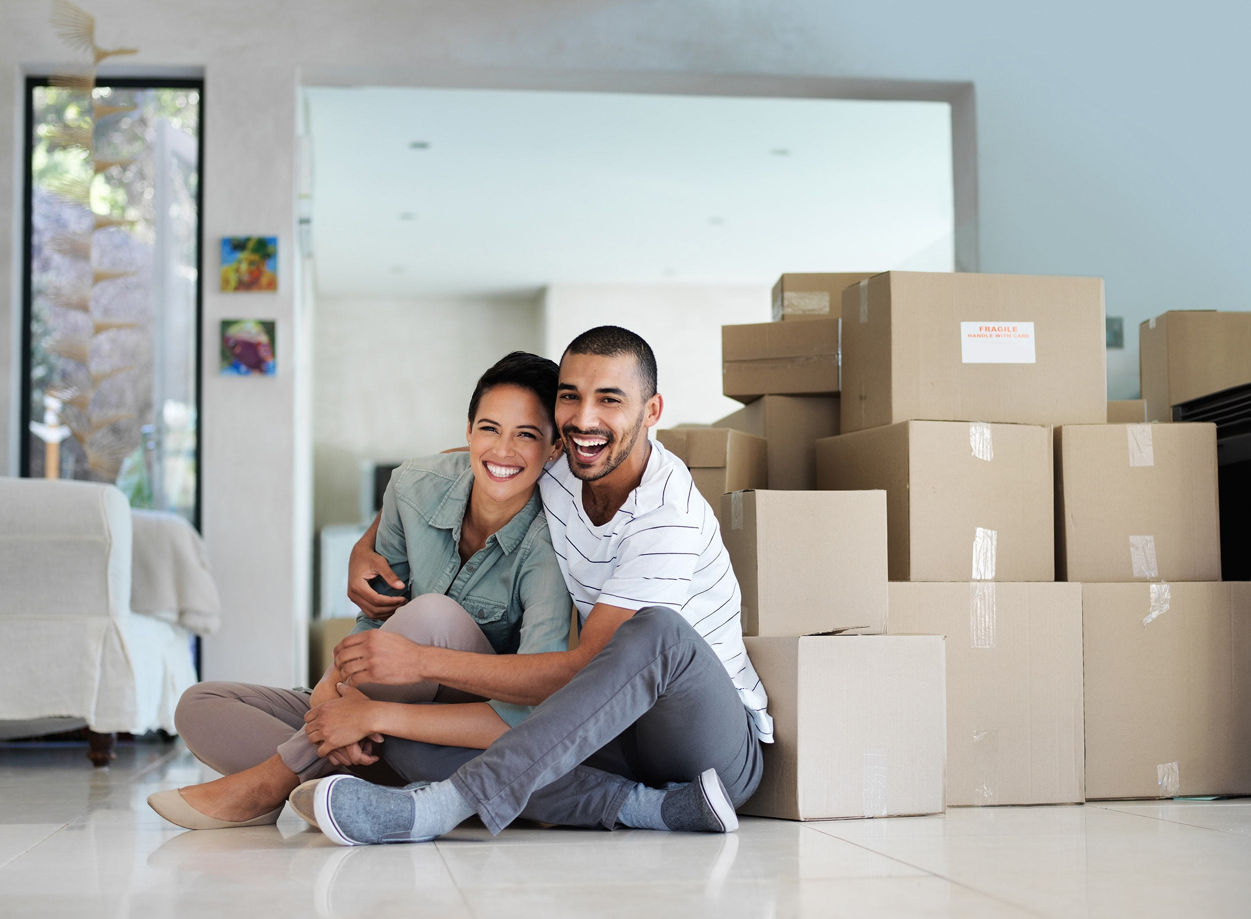 Couple Sitting in Front of Boxes