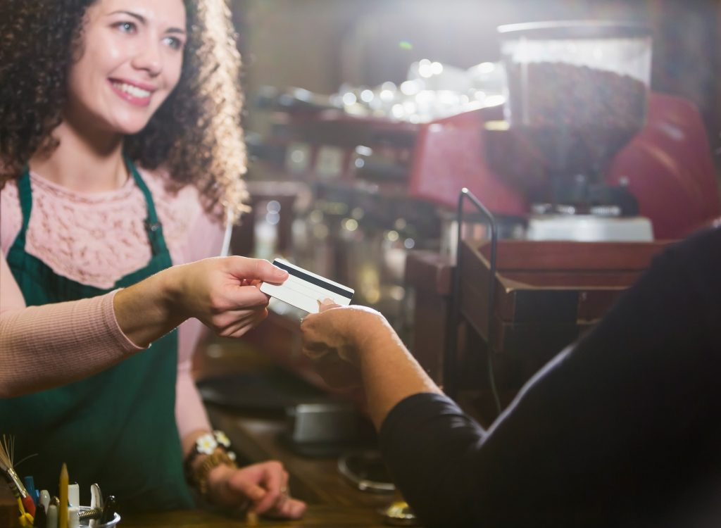 Woman Receiving Credit Card for Purchase